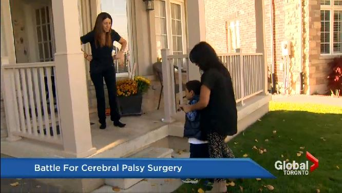 Woman helping child with cerebral palsy up stairs