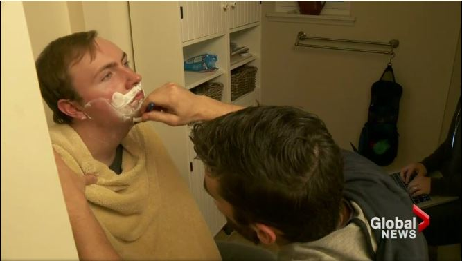 Caregiver shaving Aaron Lewis' face ahead of a night out